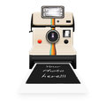 Instant camera with a blank photo Royalty Free Stock Photography