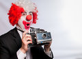 Instant camera clown Stock Image