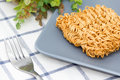 Instant noodle dried in gray dish on tablecloth Stock Images