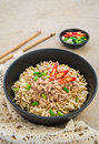 Instant noodles with pork in bowl black Royalty Free Stock Image
