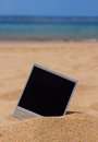 Instant photo on a beach in sand sea shore Royalty Free Stock Photos