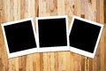 Instant photo frame on wooden Stock Photography
