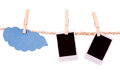 Instant photographs and cloud shape hanging on a Royalty Free Stock Photo