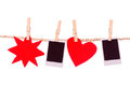 Instant photographs and red shapes hanging on a Royalty Free Stock Photo