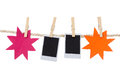 Instant photographs and star shapes hanging on a Royalty Free Stock Photo