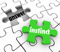 Instinct puzzle piece find answer solve puzzle gut feeling solut word on a green to solution to problem with or intuition Royalty Free Stock Photography
