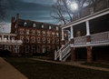 Institution courtyard creepy at night with full moon Royalty Free Stock Photography