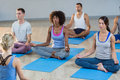 Instructor taking yoga class Royalty Free Stock Photo
