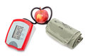 The instrument for measuring the pressure hose in shape of heart apple is a symbol of health Stock Image