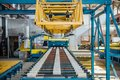 Insulation sandwich panel production line. Roller conveyor of machine tool in workshop. Selective focus