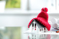 Insulation symbol close up conceptual of house with red bonnet in office burreau Royalty Free Stock Photography