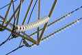 Insulators of high-voltage power lines Stock Image