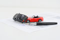Insurance policy contract concept with toy model cars having a crash