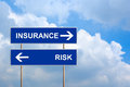 Insurance and risk on blue road sign with sky Stock Photos