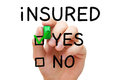 Insured yes green marker hand putting check mark with on Stock Photography