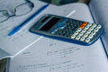 Integral calculus studying with pen glasses calculator book assignment notes Stock Images