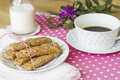 Integral cookies for breakfast oatmeal and linen on white and pink polka dots tablecloth prepared with a cup of coffee and some Royalty Free Stock Images