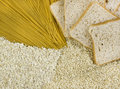 Integral food products with pasta rice slices of bread and oatmeal Royalty Free Stock Photos