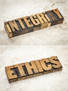 Integrity and ethics words in vintage letterpress wood type on a ceramic tile background a composite of two images Stock Images