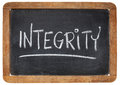 Integrity word on blackboard white chalk handwriting a vintage slate Stock Photo