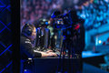 Intel extreme masters katowice poland invictus gaming playing the league of legends at iem th th march angled view with tv camera Royalty Free Stock Images