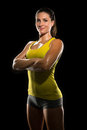 Intense determined athlete champion sweaty confident woman female powerful fighter physical trainer strong pose a portrait of a Royalty Free Stock Photo