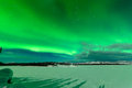 Intense display of northern lights aurora borealis spectacular or or polar forming green swirls over frozen lake laberge Stock Photos