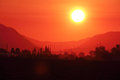 Intense morning sun an rises above the valley Royalty Free Stock Photography