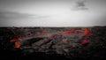 Intense red lava flow in barren landscape Royalty Free Stock Photo
