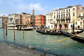 Intense summer water traffic of gondolas and ferries in Venice. Royalty Free Stock Photo