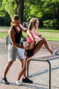 Intent couple during working out in a park Stock Image