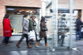 Intentional blurred image of young people in shopping center a Royalty Free Stock Photo