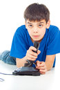 Intently boy playing video games carefully guy plays on the joystick Stock Images