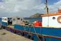An inter-island ferry loading goods at the grenadines wharf, st. vincent Royalty Free Stock Photo