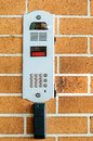Intercom the on the orange wall Royalty Free Stock Images