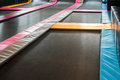Interconnected trampolines for indoor jumping.