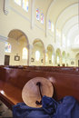 Intercultural religions catholic church in vietnam with a vietnamese hat forgotten on the chair Stock Photography