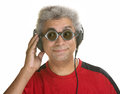 Interested man with headphones mature male sunglasses and Royalty Free Stock Image