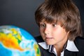 Interested school boy with globe Royalty Free Stock Photo