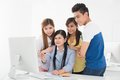 Interested students group of classmates being in what their teacher is pointing at on the screen Royalty Free Stock Images