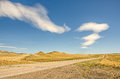 Interesting clouds in big sky country over an open road with no traffic Stock Photo