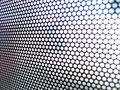 Interesting thin metallic perforated surface Stock Photo