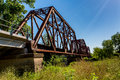 An interesting view of an old iconic iron truss railroad bridge over the brazos river texas Royalty Free Stock Image