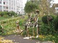 interesting wooden sculpture family with a dog on the playground called `Good fairy tale` Royalty Free Stock Photo
