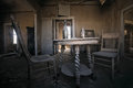 Interior of  abandoned old western building with two old chairs and table Royalty Free Stock Photo