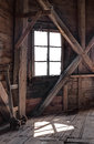 Interior of an abandoned wooden house with light coming through the window Royalty Free Stock Photo