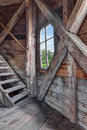 Interior of an abandoned wooden house with staircase and view over green garden Royalty Free Stock Photography