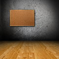 Interior backdrop with corkboard blank grunge wall and wooden floor hanging for your design Royalty Free Stock Images