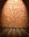 Interior backdrop wooden floor brick wall spotlight Royalty Free Stock Image