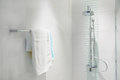 Interior of bathroom with modern shower head and white towel Royalty Free Stock Photo